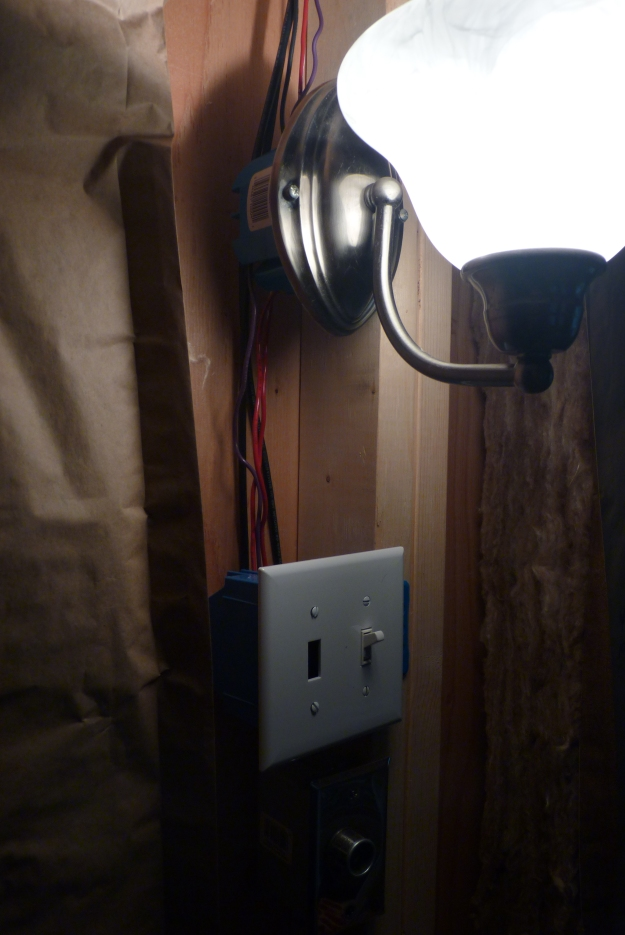 new wall sconce, switch for that one and the ceiling light, (switch not wired in yet but the wires are in place behind) and 12 volt outlet.